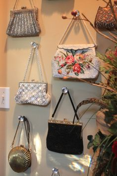 I bought similar knobs shown here at Hobby Lobby.  I'm connecting mine to small squares of wood for support and hanging my purse collection.  Great Idea!