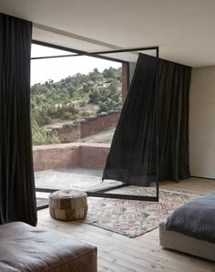 Unique glass door design that leads out to a rolling landscape in Morocco [395 x 500]