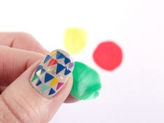 Make your own nail decals. Paint polish on plastic surface, peel off, and cut to desired shape. Place on wet polish and seal with a top coat.