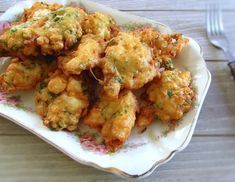 Salt cod fritters on a platter Cod Dishes, Fish Dishes, Cod Fish Recipes, Seafood Recipes, Salted Cod Fish Recipe, Cod Fritters Recipe, Eggs In Peppers, Tomato Rice, Portuguese Recipes