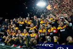The Chiefs celebrate the 2012 Super Rugby Championship win over the Sharks at Waikato Stadium.