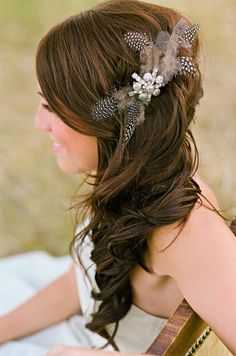 side swept hair. beautiful for wedding hair. love the rustic feel & hair piece with feathers