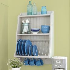 KITCHEN UPGRADE: If you're looking for a way to dramatically boost the charm and functionality of your kitchen, consider adding an open plate rack. It mounts to the wall, leaving counters uncluttered, and gets your dishes out in the open—easy to gra Wooden Plate Rack, Diy Plate Rack, Plate Rack Wall, Wooden Plates, Wall Mounted Dish Rack, Cabinet Plate Rack, Diy Kitchen, Kitchen Storage, Kitchen Decor
