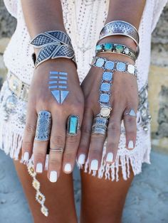 Stacking bracelets and layered jewelry rings for a cool boho street style look