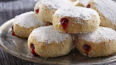 Biscuits filled with strawberry jam and coated in powdered sugar make for a spooky and tasty Halloween treat!