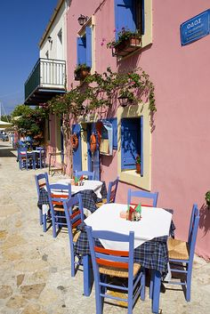 Tables outside a Greek taverna, Fiskardo, Kefalonia.