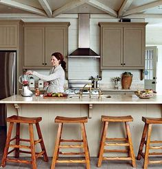 Rustic Kitchen- love the taupe painted cabinets and simple/rustic bar stools and wood beams