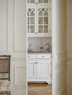 hidden pantry with doors that match the wall