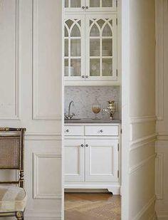 hidden door...  gothic tracery in cabinet doors...  <3