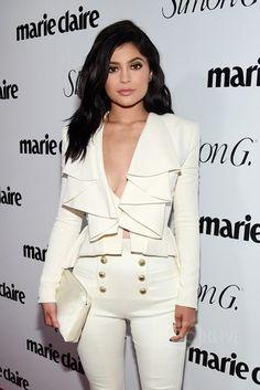 Kylie Jenner wearing Le Vian Ring, The Row Wristlet Tasseled Silk-Satin Clutch, Gianvito Rossi Gianvito Rossi Pointed Toe Pumps, Balmain FW16 Suit, Harry Kotlar Diamond Earrings