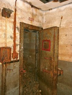 "Magazine B - Inside the ""personnel room"" showing the doorway with heavy ""blast"" door leading to the ""personnel hatch"" at the west end of the magazine."