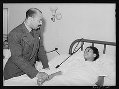 """The concept of separate but equal facilities covered all areas of life and business. Here is an African American doctor looking after one of his patients in one of Chicago's """"blacks only"""" hospitals as photographed by Russell Lee in 1941"""
