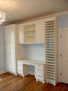 now THIS craft room is what I dream about.  Built in shelves and cabinets with paper storage!!!  This womans hubby had it all built for her.  I have never been lucky enough to have a hubby that cou