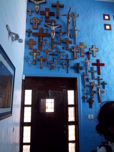 An entrance door, color and a collection of crosses