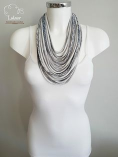 Handmade multi strand necklace. Made of tie-dye grey and blue t-shirt yarn (cotton fabric) That is very light and soft. This beautiful necklace will jazz up any plane outfit. For cleaning, wash by hand and dry naturally. Size: approx. 36cm long I can make this necklace in different colors