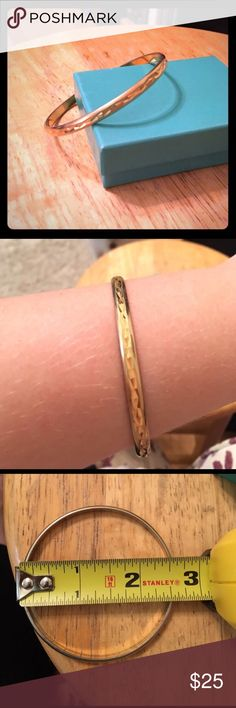🎉01/06 HP🎉 Gold Tone Monet Bracelet Gold plated Monet Bracelet. Has some wear on the edges, best shown in photo 4. Great for stacking on your arm and bundling online for discounts! Monet Jewelry Bracelets