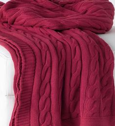 Like your favorite sweater, our cable knit red throw blanket is meant to wrap up in and stay cozy. Cranberry red makes our cotton throw a stylish accent begging to be tossed on the sofa, your favorite
