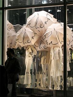 LOVE these umbrellas! Tokyo shop window, Burberry. You could write or stencil whatever you want on the umbrellas (SALE, for example). Love the idea of using umbrellas in a store window!