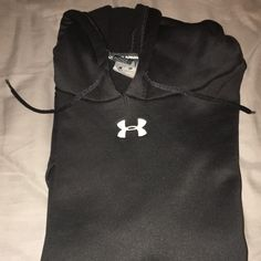 Under Armour Hoodie This Under Armour Hoodie has been worn couple of times. It's 100% polyester. My bra size is a 36D and its fits me just right with a little room to wiggle which I like. Under Armour Sweaters