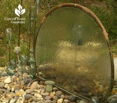 Old glass tabletop turned water fountain - with copper tubing and rock garden - beautiful!