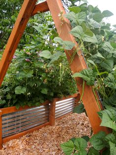 Raised bed with metal and cedar posts. Would also add a cedar cap for seating where it isn't under a teepee