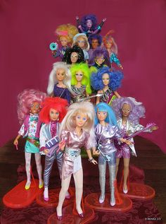 """I use to love Jem!  Sure she kinda looks like a barbie your little sister drew on an played """"hair salon"""" with, but she was in a an 80s rock band!  Enough said."""