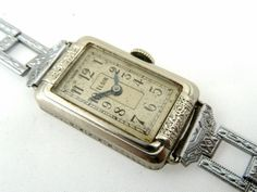 A ladies Elgin watch circa 1920. Slim and elegant. Perhaps worn by Miss Lemon?