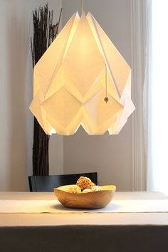 HANAHI (a flower in Japanese) is a handmade lamp shade made in high quality paper using the ancient Japanese paper folding method Origami, #OrigamiLamp