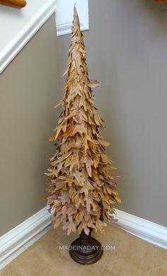 Tree from fall leaves... would definitely kick it up a notch with bronze glitter paint at bottom edge tip of leaves.