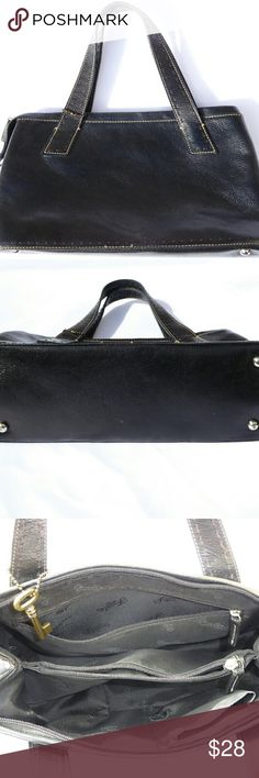 """Fossil Black Leather Retro Handbag For sale is this shiny, black leather retro handbag, by Fossil.  Interior is lined with black """"Fossil 1954"""" lining.  Has 2 zip and one slip pocket.  Metal feet for bottom protection. Brown and tan stitching, brass logo key.  Top zip closure.  Straps hang about 5.5"""".  13.5""""L x 7.25""""H x 4.5""""D.  Bag shows wear or top crease, otherwise great condition and clean interior. Fossil Bags"""