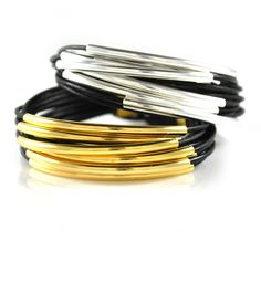 """Leather wrap bracelets with multiple strands of leather in 12 different color choices. Clasps and beads in gold plated or silver plated. 7.5"""" length is standard."""