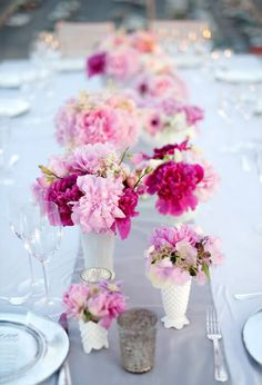 Fresh flower centerpieces in various shades of pink - beautiful.