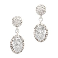 Up the drama with the  Ariella earrings. Not your every day two-drop, Arielle features a large CZ-bordered oval druzy stone, and CZ-encrusted silver domes.  Find it on Splendor Designs
