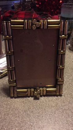 Picture frame with empty bullet shells :)