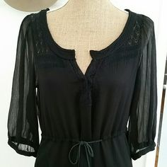 """Free People Gorgeous Black Tunic Dress Made in India.  All Polyester.  Gauze type light weight sheer fabric .  Beautiful feel.  Lovely crochet detail.  Ruffle bottom hem.  Tag says XS.  But has a loose fit.  Can fit a size Med as well.  Has a leather tie waist. Front has hook closure to top of neck,  can open more than photo shows as well. Top hook a little loose..can be sewn tighter. 32"""" length. Waist laid flat: 17.5""""(without tie pulled).  Pit to pit: 18"""" Free People Dresses Mini"""