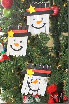 Snowmen faces made from craft sticks.