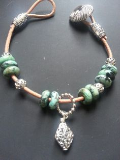 Leather bracelet with turquoise beads, button clasp.