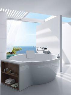 Circular freestanding bathtub with an Ocean view