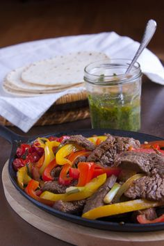 Steak Fajitas with Grilled Onions, Peppers, and Roasted Cherry Tomatoes with Chimichurri Sauce