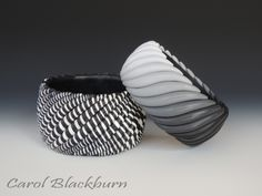 Carol Blackburn, bangles - one with black to white plain snakes and one in twisted snakes, polymer clay.
