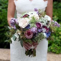 Gina's textured bouquet was filled with purple and white Queen Anne's lace, garden roses, ranunculus, lilacs, lavender and brunia berries