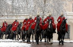 London in the snow. Love this Great British winter scene. The Life Guards' Squadron of the Household Cavalry Mounted Regiment rides to work through thick snow to take up its 24-hour duty at Horse Guards Parade. Photographer Sgt Ian Houlding; Crown copyright.