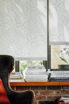 modern window treatments for living room build in blind comfy chair and stack of books waiting to be read these roller shades 65 best love your living room windows images on pinterest in 2018