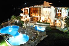 12 Architecturally Stunning Mansions You Can Rent For Your Next Vacation - Villa El Cid is located in Marbella, Spain, and starts at $2,258 per night. It is a water-lover's paradise with heated indoor and outdoor swimming pools and three Jacuzzis. It also has a tennis court and putting green.