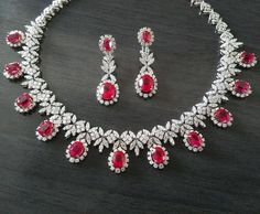 Aarya Jewelry proudly presents this necklace & earrings set beautifully crafted with 65.83 carats of flawless white diamonds & rubies in 18K white gold #AaryaJewelry    #DiamondJewelry #GoldJewelry #DiamondNecklace #GoldNecklace #DiamondEarrings #GoldEarrings #Bespoke #Necklace #Earrings #Sparkles #18K #WhiteGold #Ruby #Gift #ForYou #ForHer #DiamondsAreForever #Luxury #LuxuryJewelry #Jewellery #instajewelry #Gold #whatwomenwant #love #Fashion #LuxuryLifestyle #luxuryfashion #LuxuryLife