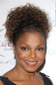 This hairstyle is a scene stealer as Janet Jackson's hair is very curly. The curls are soft and the look, romantic. A great style for a wedding or prom.Janet's hair is cut medium length.The hair colour is a dark brown.