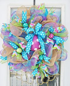 Easter Egg Wreath Pastel Easter Wreath for sale on Etsy by TrendyWreathBoutique, $82.99 https://www.etsy.com/listing/180761342/easter-egg-wreath-pastel-easter-wreath