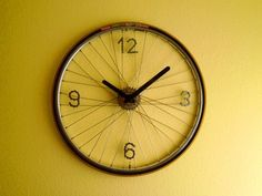 Bike Wheel Clock made by Máté Csipszer, at Recyclart.org. Love that the numbers are made from bike chain.
