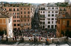 A wine bar overlooking Piazza di Spagna in Rome. The crowd of people is where the Spanish Steps are.