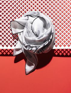 Scarf with laser-cut paper.